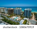 Small photo of Aerial drone shot of Miami Beach midrise condos on the ocean