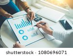 two business point a pen to... | Shutterstock . vector #1080696071