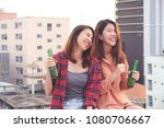 two asian women drinking at... | Shutterstock . vector #1080706667