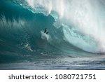 Surfer Wipes Out On A Huge Wave