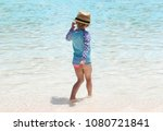 girl with a straw hat in a pool ... | Shutterstock . vector #1080721841