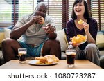 couple having fast food on the... | Shutterstock . vector #1080723287