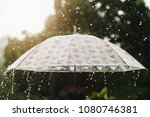 rain drop falling onto umbrella ... | Shutterstock . vector #1080746381