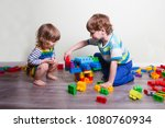 two children  playing with lots ... | Shutterstock . vector #1080760934