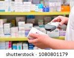 pharmacist scanning barcode of... | Shutterstock . vector #1080801179