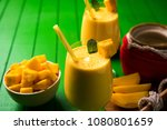mango lassi or smoothie in big... | Shutterstock . vector #1080801659