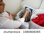 asian woman and washing machine | Shutterstock . vector #1080808385