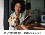 mixed race woman petting her...   Shutterstock . vector #1080831794