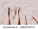 legs in sand of the summer... | Shutterstock . vector #1080945371