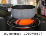 burning blue gas. focus on the... | Shutterstock . vector #1080945677
