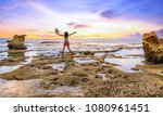 young female tourist jumps in... | Shutterstock . vector #1080961451