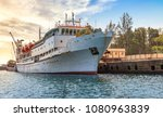passenger ship docked at port... | Shutterstock . vector #1080963839