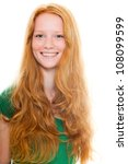 Small photo of Smiling pretty girl with long red hair wearing green shirt. Fashion studio shot isolated on white background.