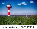 lighthouse elbe germany with... | Shutterstock . vector #1080997994