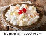 fruit salad from pineapple ... | Shutterstock . vector #1080998849