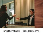 woman at reception giving her... | Shutterstock . vector #1081007591