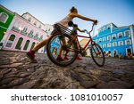 unrecognizable woman pushing a... | Shutterstock . vector #1081010057