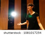 young actor in a theater. | Shutterstock . vector #1081017254