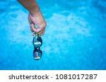 man hand holding swimming... | Shutterstock . vector #1081017287
