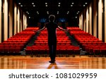 young actor in a theater. | Shutterstock . vector #1081029959