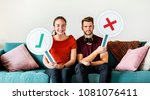 couple showing yes and no sign | Shutterstock . vector #1081076411