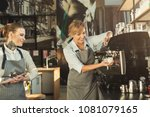 skilled barista teaching young... | Shutterstock . vector #1081079165