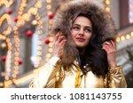 young beautiful woman in golden ... | Shutterstock . vector #1081143755