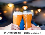 enjoy clinking draft beer with... | Shutterstock . vector #1081266134