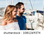 young couple in sunny harbor ... | Shutterstock . vector #1081269374