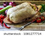 raw goose  ready to cook ... | Shutterstock . vector #1081277714
