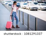 woman with phone at airport | Shutterstock . vector #1081291337