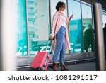 woman with phone travelling   Shutterstock . vector #1081291517