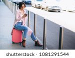 woman with phone at airport | Shutterstock . vector #1081291544
