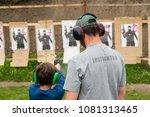 gun instructor teaching young...   Shutterstock . vector #1081313465