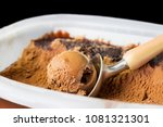 Stock photo chocolate ice cream and a scoop coffee creme brulee tasty ice cream scoop with chocolate crumbs 1081321301