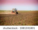 tractor fertilize field before... | Shutterstock . vector #1081331801