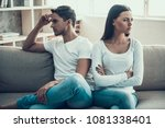 Small photo of Frustrated young couple quarreled. Family quarrel. Household squabble