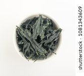 Small photo of Heap of Dry Wakame Seaweed Isolated on White Background. Healthy Algae Food