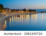 people walking at an embankment ...   Shutterstock . vector #1081345724