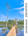 Small photo of The path towards to Neak Pean temple on artificial island. Siem Reap, Cambodia