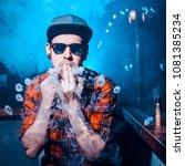 punk hipster man is smoking a... | Shutterstock . vector #1081385234