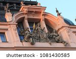 Small photo of sculpture on a building in Prague, Czech Republic: the three Moirai or Fates of the Greek mythology: Clotho, Lachesis and Atropos; the child and the three-headed dog Cerberus represent birth and death