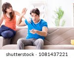 wife unhappy that husband is...   Shutterstock . vector #1081437221