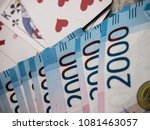 Small photo of pack of money and playing cards