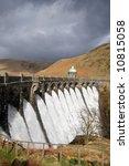 Water overflowing a dam, Craig Goch reservoir, Elan Vally Wales. - stock photo
