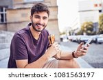 young man eating lunch and... | Shutterstock . vector #1081563197