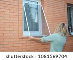 woman installing mosquito wire... | Shutterstock . vector #1081569704