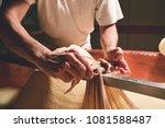 a cheesemaker prepares a form... | Shutterstock . vector #1081588487