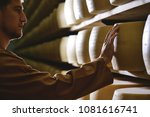 a cheesemaker controls the... | Shutterstock . vector #1081616741