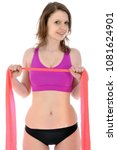 Small photo of Beautiful sporty young woman in sportswear is exercising with thera band as gymnastics ribbon isolated on white